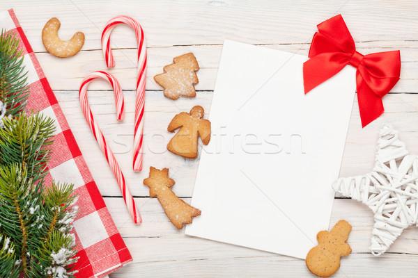 Karácsony üdvözlőlap mézeskalács sütik hó fenyőfa Stock fotó © karandaev
