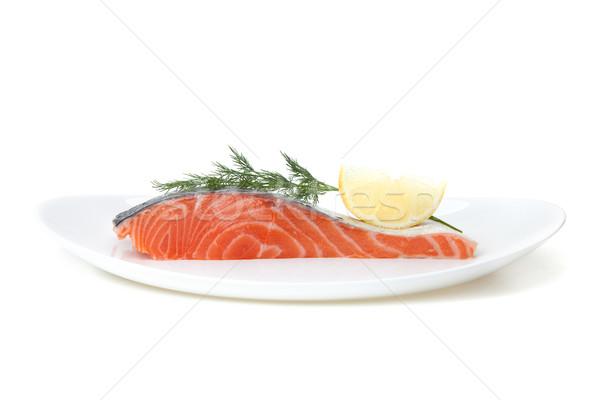 Piece of salmon with lemon and dill on plate Stock photo © karandaev