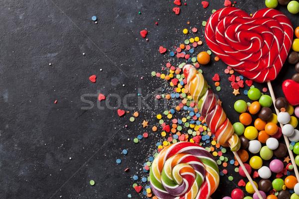 Stock fotó: Színes · cukorkák · sötét · kő · felső · kilátás