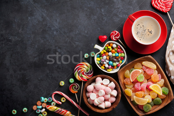 Coffee, colorful candies, jelly and marmalade Stock photo © karandaev