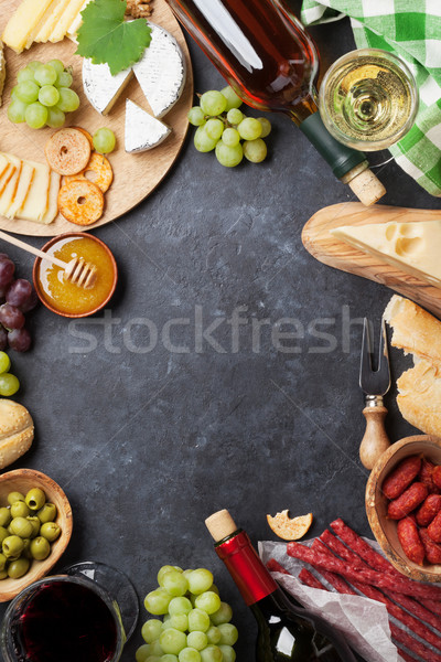 Wine, grape, cheese and sausages Stock photo © karandaev