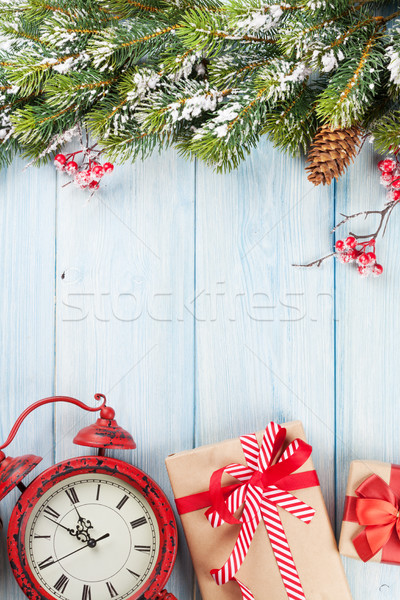 Christmas background with tree, alarm clock and gifts Stock photo © karandaev