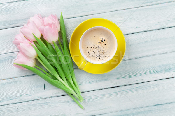Pink tulips and coffee cup on wooden table Stock photo © karandaev
