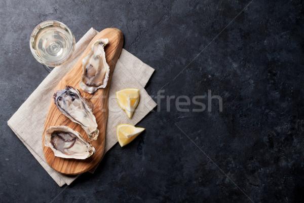 Oysters and wine Stock photo © karandaev