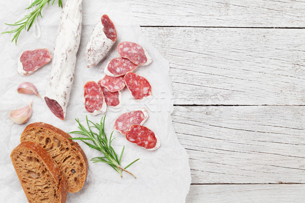 Salami brood vlees houten tafel top Stockfoto © karandaev