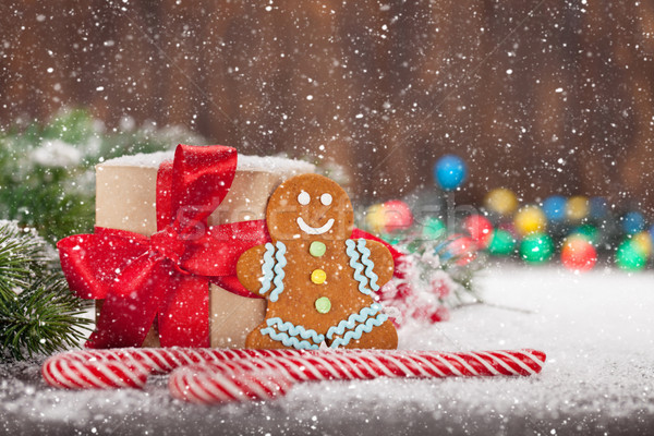 Stock photo: Christmas gift box, candy canes and gingerbread man