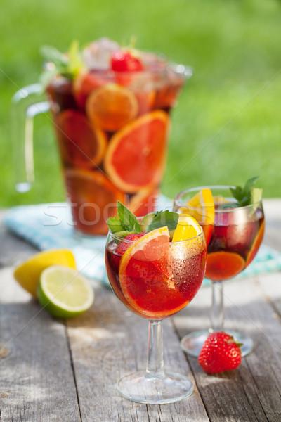 Frissítő gyümölcs fa asztal étel bor üveg Stock fotó © karandaev