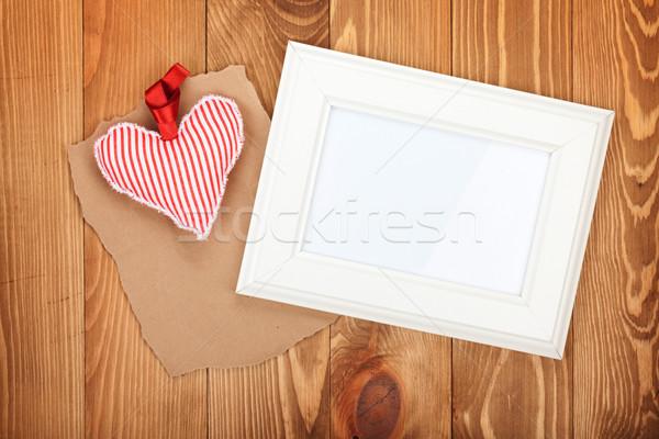 Blank photo frame and red Valentine's day heart toy Stock photo © karandaev