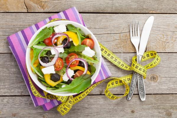 Friss egészséges saláta ezüst étkészlet mérőszalag fa asztal Stock fotó © karandaev
