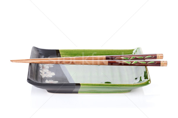 Chopsticks and plate Stock photo © karandaev
