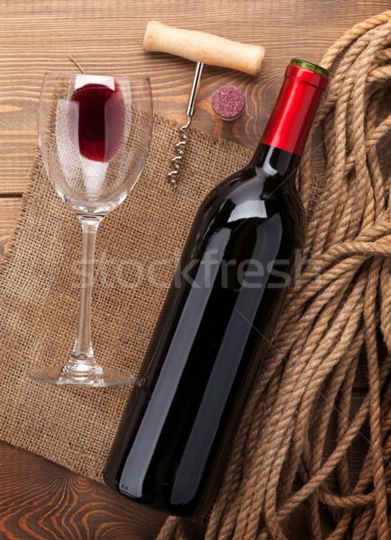 Red wine bottle, glass, cork and corkscrew. View from above Stock photo © karandaev