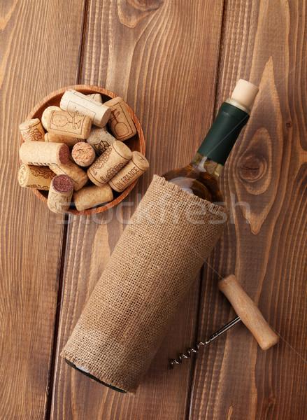 Garrafa de vinho branco mesa de madeira topo ver textura Foto stock © karandaev
