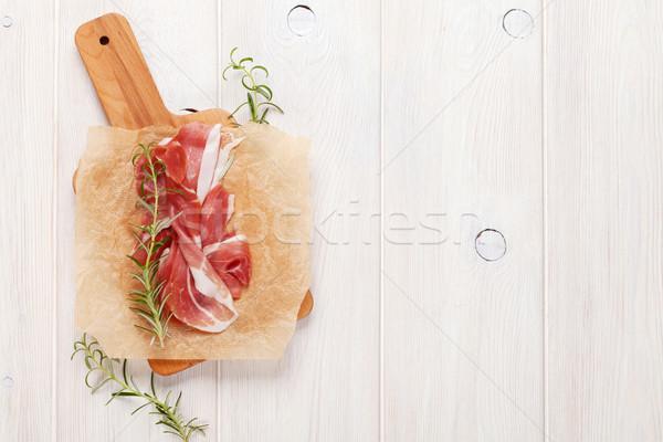 Prosciutto rozmaring vágódeszka felső kilátás copy space Stock fotó © karandaev