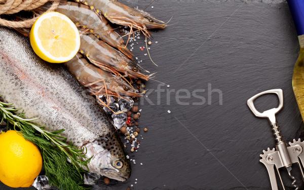Fresche greggio mare alimentare spezie bottiglia di vino bianco Foto d'archivio © karandaev