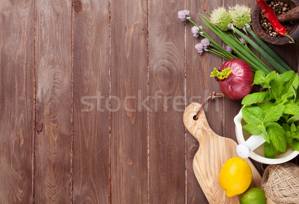 Fresh herbs and spices on garden table Stock photo © karandaev