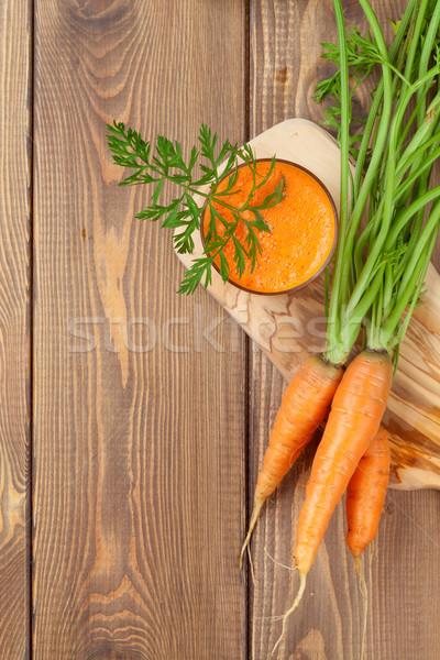 Fresh carrot juice smoothie and roots Stock photo © karandaev