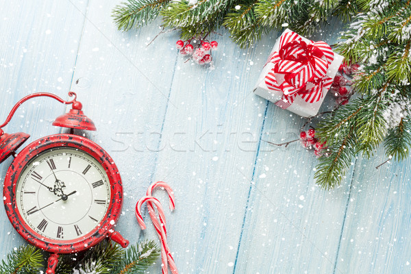 Stock photo: Christmas gift box, alarm clock, candy cane and fir tree
