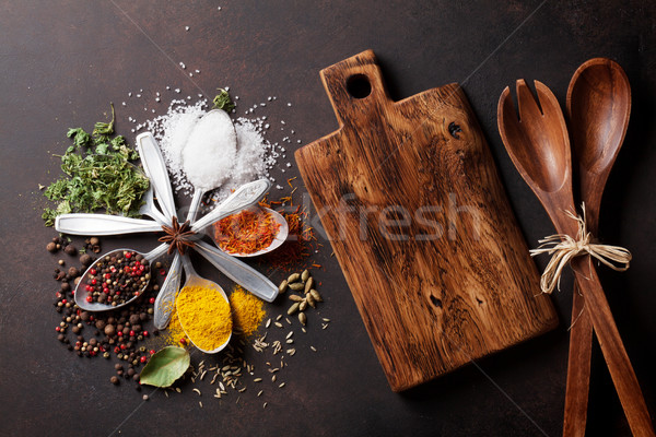 Various spices spoons on stone table Stock photo © karandaev
