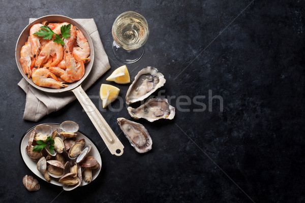 Fresh seafood and white wine. Scallops, oysters and shrimps Stock photo © karandaev