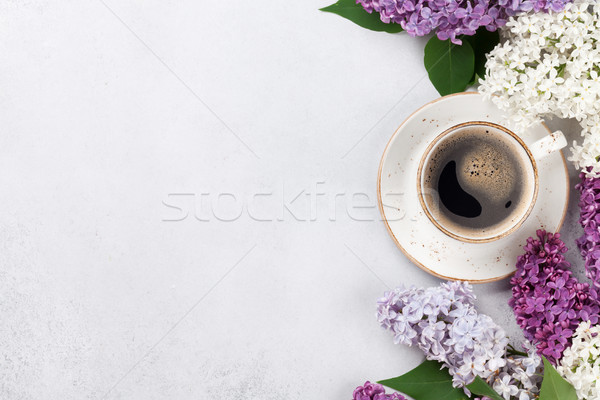 Stock photo: Colorful lilac flowers and coffee cup