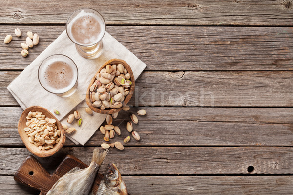 Photo stock: Bière · collations · pierre · table · noix