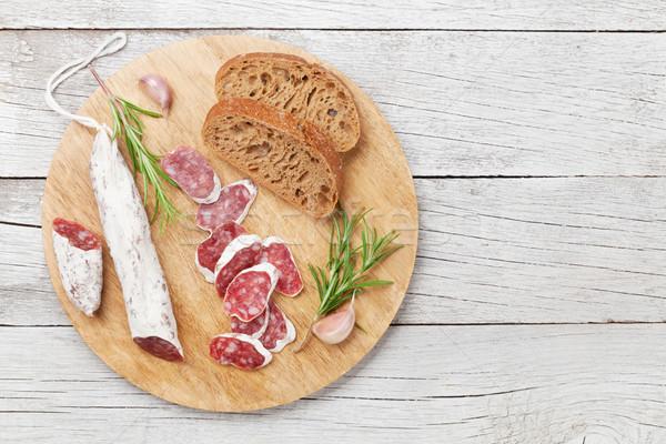 Szeletel szalámi vágódeszka hús fa asztal felső Stock fotó © karandaev