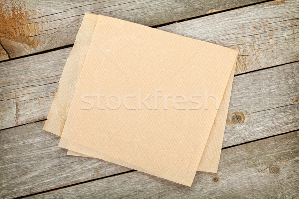Cooking paper over wooden table Stock photo © karandaev