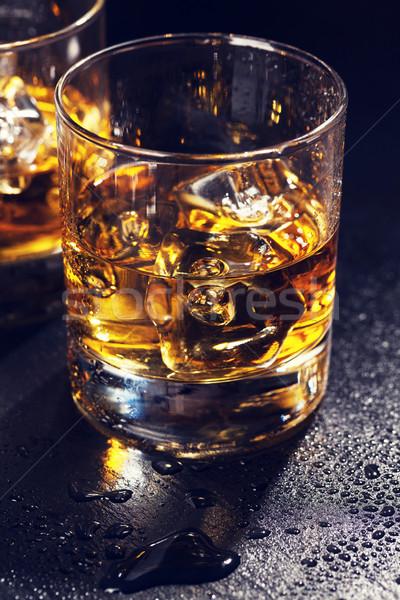 Glasses of scotch whiskey with ice Stock photo © karandaev