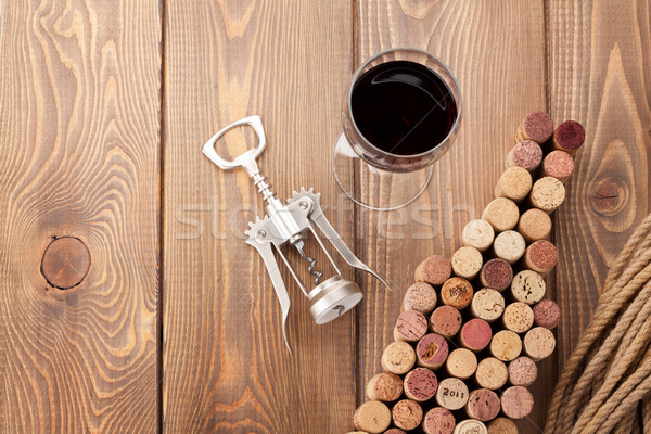 Wine bottle shaped corks, glass of wine and corkscrew Stock photo © karandaev