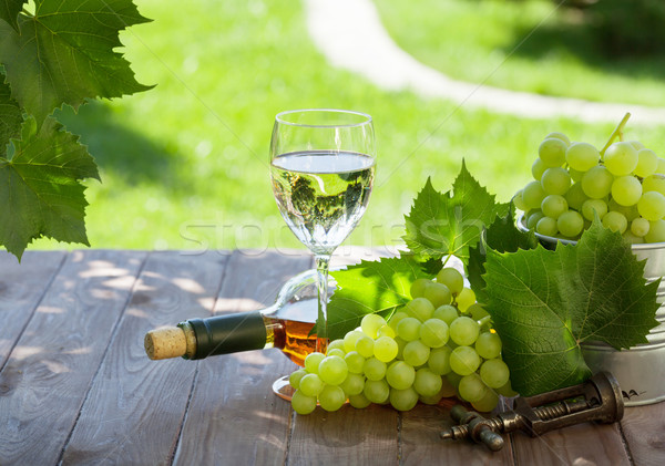 White wine bottle and glass with white grape Stock photo © karandaev