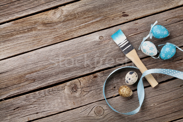 Colorful easter eggs and paint brush Stock photo © karandaev