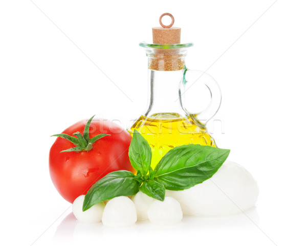 Mozzarella cheese, olive oil, tomato and basil Stock photo © karandaev