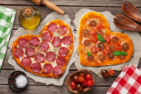 Heart shaped pizza with tomatoes and mozzarella and pepperoni Stock photo © karandaev
