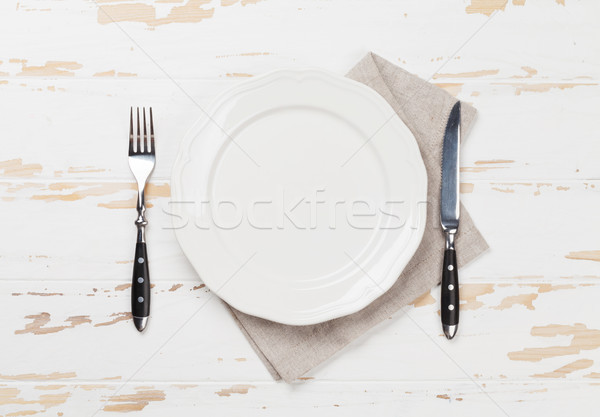 Empty plate with silverware Stock photo © karandaev