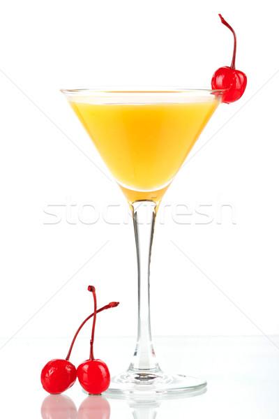 Alcohol cocktail with orange juice and three maraschino Stock photo © karandaev