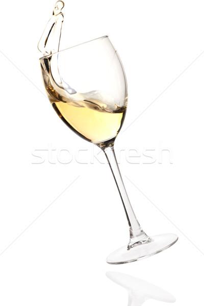 Splashing white wine in a falling glass Stock photo © karandaev