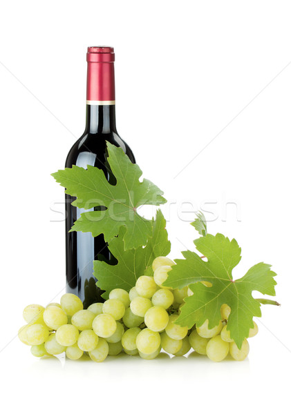 Red wine bottle and grapes Stock photo © karandaev