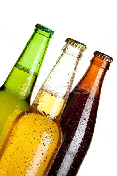 Trois bière bouteilles ensemble isolé Photo stock © karandaev