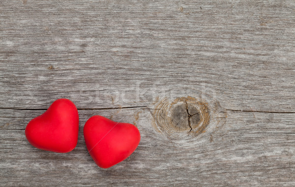 Two candy hearts on wooden background Stock photo © karandaev