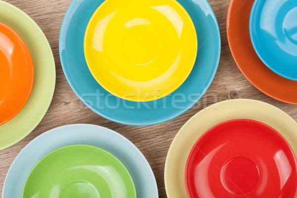 Színes tányérok fa asztal felülnézet étel terv Stock fotó © karandaev