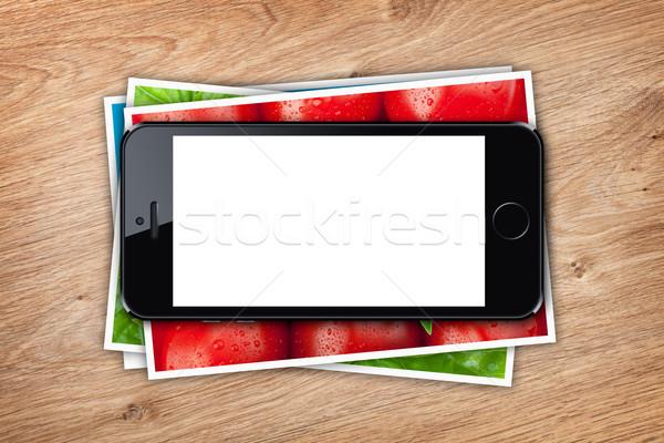 Telefonu ekranu wydrukowane zdjęcia kolaż Zdjęcia stock © karandaev