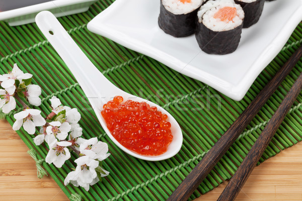 Red caviar, sushi set, sakura branch and chopsticks Stock photo © karandaev