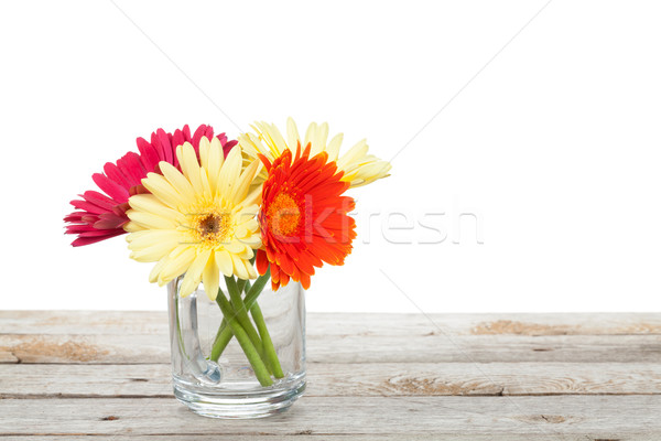 Colorful gerbera flowers on wooden table Stock photo © karandaev