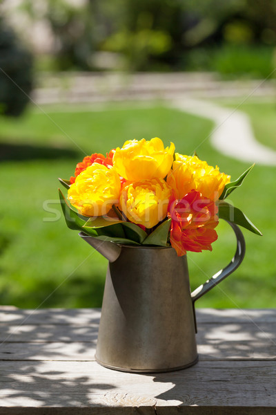 Colorful tulips bouquet in watering can Stock photo © karandaev