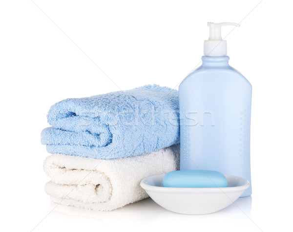 Shampoo bottle and soap with towels Stock photo © karandaev