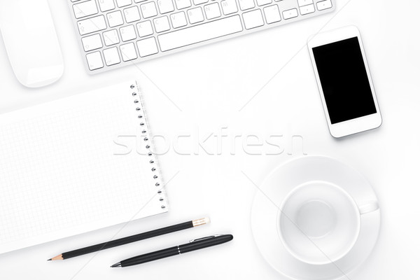 Office desk table with computer, supplies and coffee cup Stock photo © karandaev