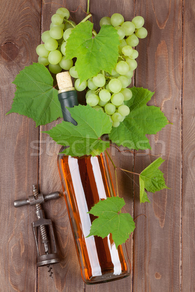 Bunch of grapes, white wine and corkscew Stock photo © karandaev