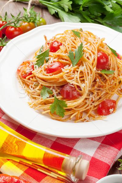 Spagetti tészta paradicsomok petrezselyem fa asztal fa Stock fotó © karandaev