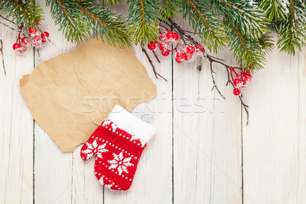 Christmas wooden background with fir tree and mitten decor Stock photo © karandaev