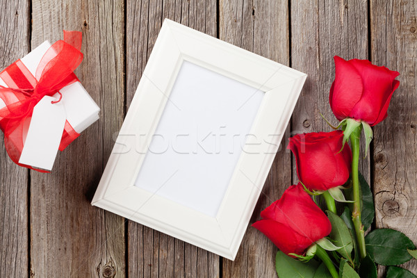 Photo frame, red roses and Valentines day gift Stock photo © karandaev